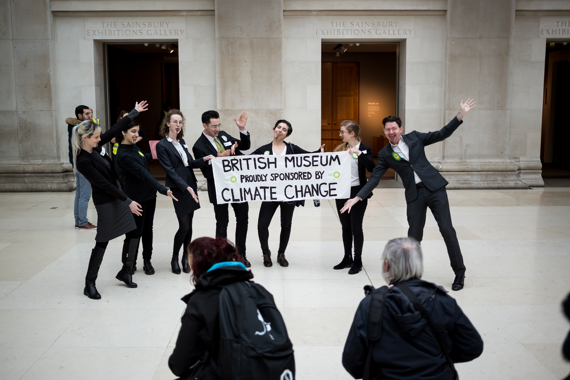 Protestors from Fossil Free London hold a banner about the British Museum's complicity in climate change