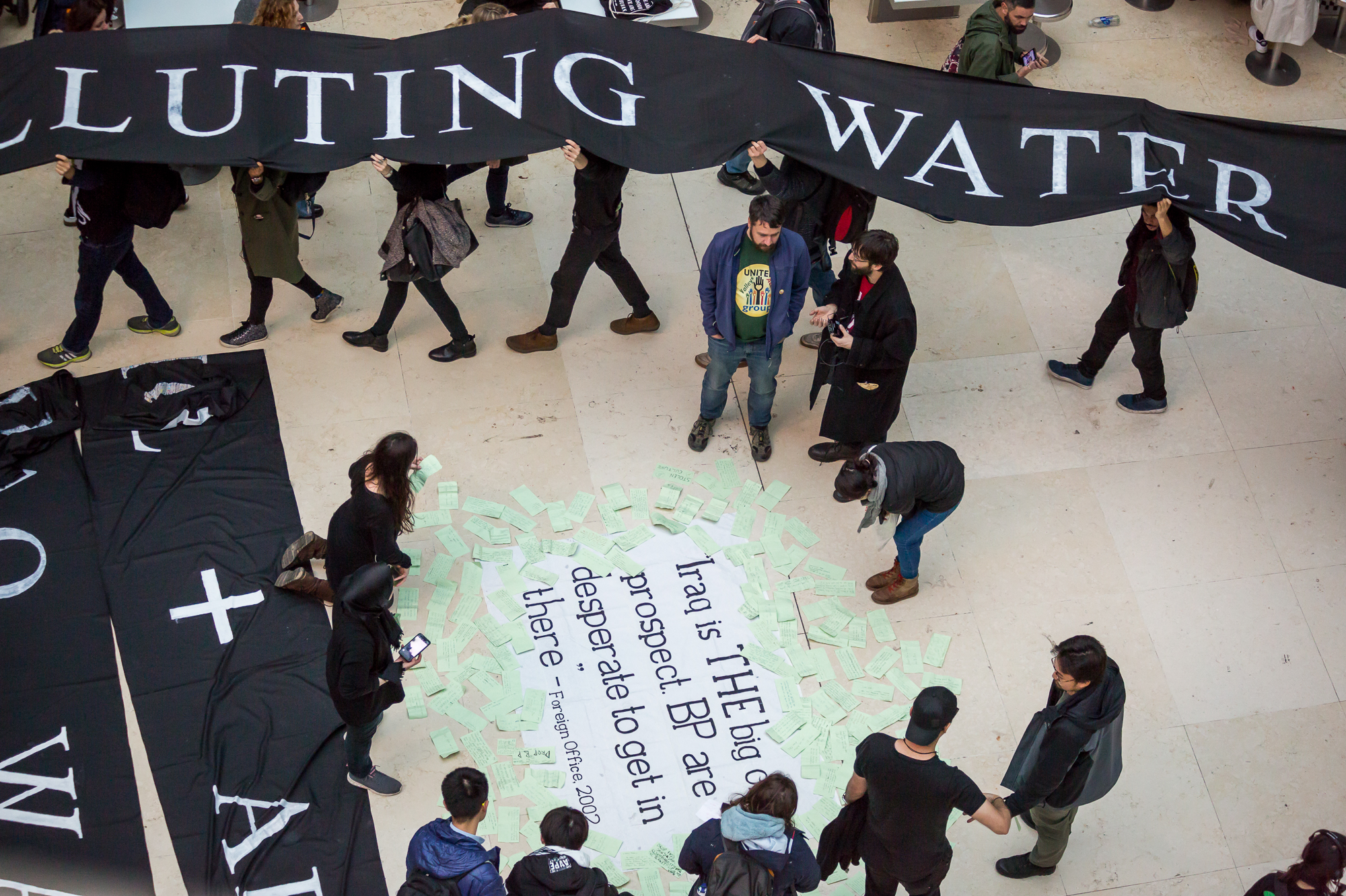 Messages from the public to the British Musuem are scattered around the Foreign Office quote (2002), whilst protestors file out with of the museum with the 'living tapestry'.