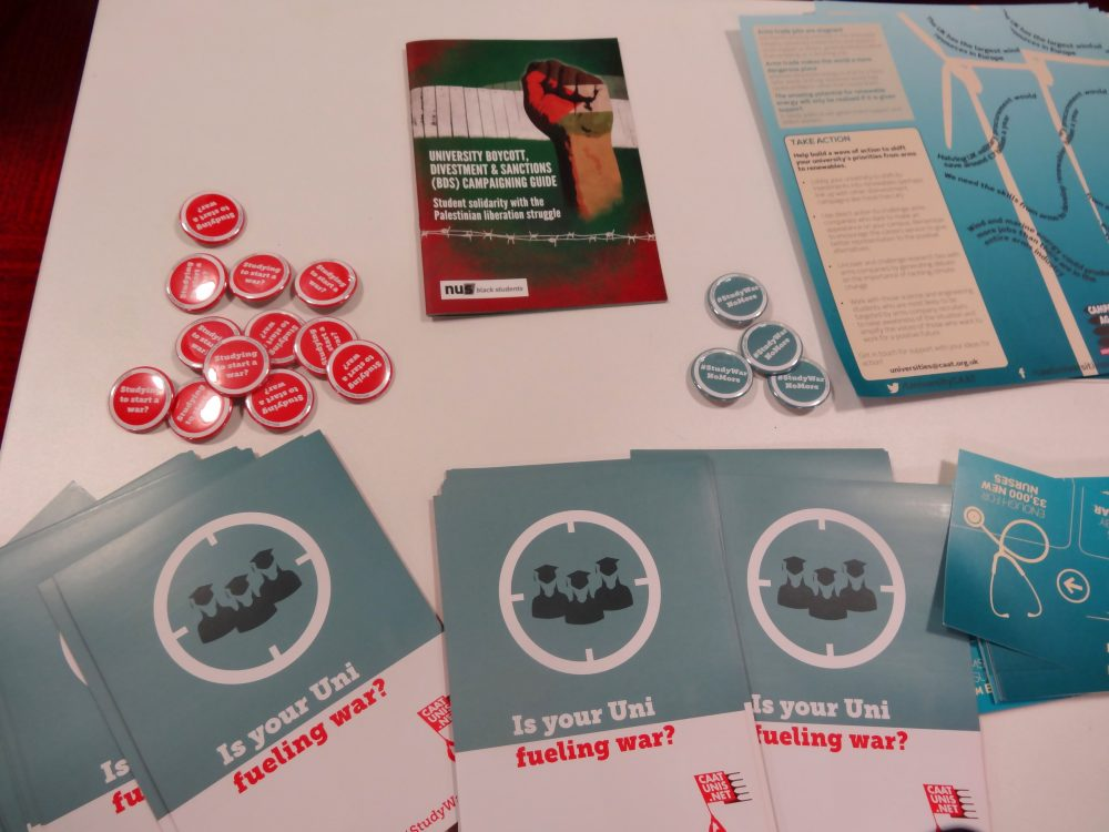 Badges and leaflets on anti-arms trade campaigning