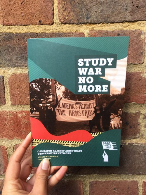 Study War No More campaign guide held up by a hand