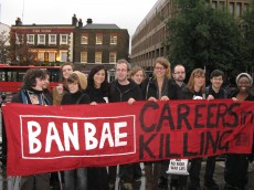 Protesters with banner reading 'Ban BAE: Careers in Killing'