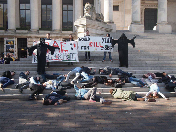 Portsmouth students stage a die-in with grim reapers outside the careers fair