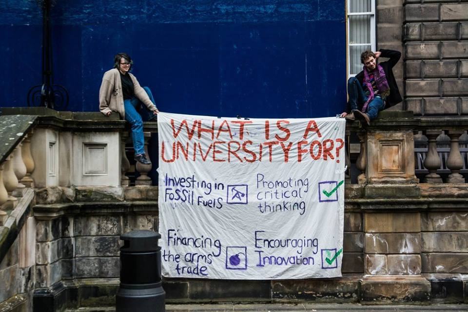 Edinburgh students hold divest from arms trade and fossil fuels banner