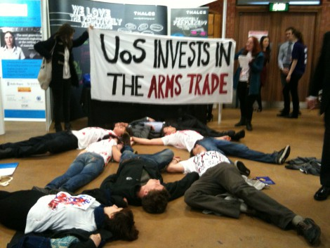Sheffield students hold a 'die-in' outside arms company Thales' stall