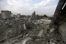 Picture of a destroyed urban area, rubble everywhere